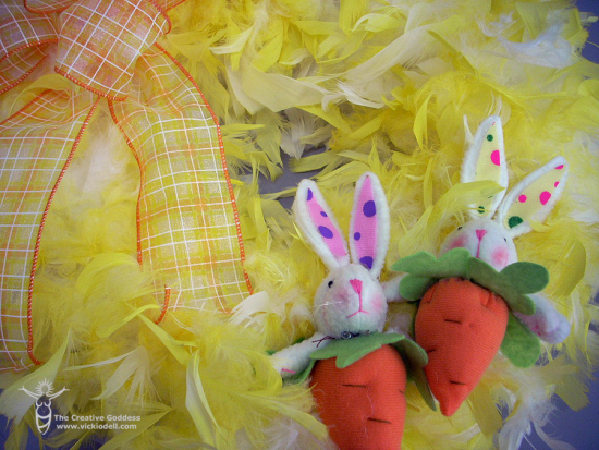 attach Easter bunny to feather wreath