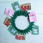 Christmas card display wreath using Krylon, and clothespins
